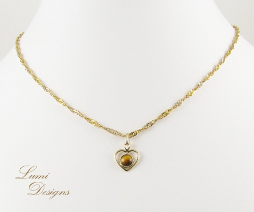 Pendant 'Tiger's Heart' with tiger eye and gold (585)